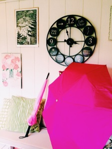 My office with Meg's pink umbrellas and vintage typewriter clock