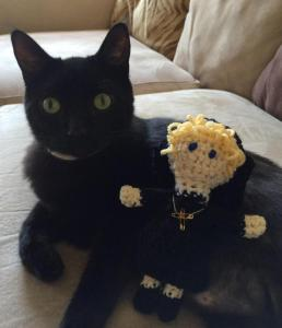 nun doll with cat